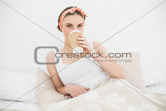 Woman drinking coffee looking into the camera