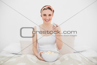 Smiling woman watching television