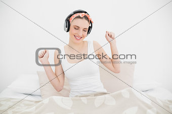 Young woman moving while wearing headphones