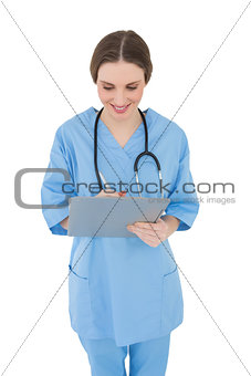 Smiling female doctor working with her clipboard
