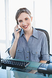 Friendly businesswoman phoning with her smartphone