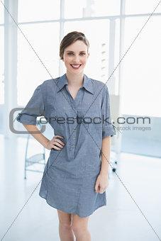 Beautiful calm businesswoman posing in office