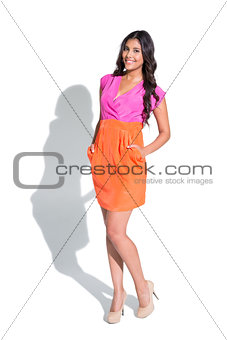 Smiling attractive brunette posing and looking at camera