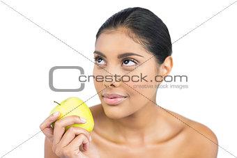 Calm nude brunette holding green apple