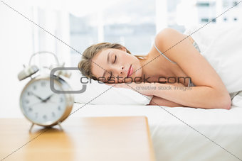 Attractive woman lying in her bed sleeping