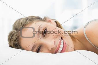 Content calm woman lying in her bed in the bedroom