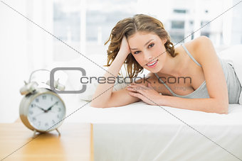 Attractive woman lying in her bed in the bedroom