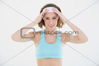 Portrait of beautiful brunette woman posing wearing sportswear