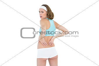 Attractive woman wearing sportswear looking at camera
