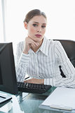 Serious businesswoman sitting at her desk