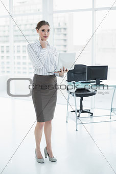 Thoughtful chic businesswoman holding her notebook