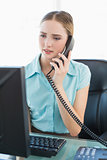 Classy frowning businesswoman phoning