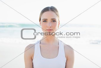 Beautiful young woman sitting on the beach