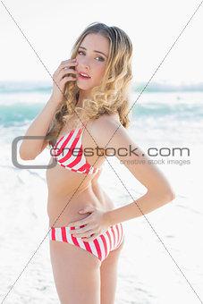 Beautiful young woman wearing a red bikini
