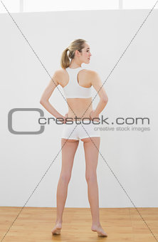 Beautiful toned woman posing in sportswear