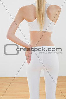 Slim toned woman posing in sportswear with hand on hip