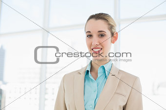 Portrait of attractive classy businesswoman posing in her office