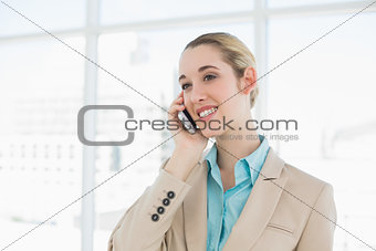 Beautiful chic businesswoman phoning with her smartphone
