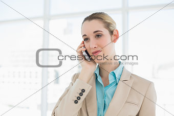 Calm businesswoman phoning with her smartphone