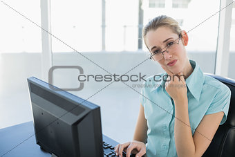 Attractive thoughtful businesswoman working on her computer