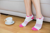 Young slender woman wearing pink socks