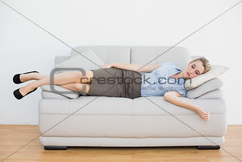 Attractive peaceful businesswoman sleeping lying on couch
