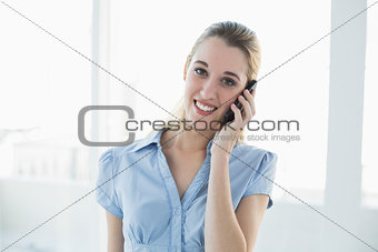 Attractive blonde businesswoman phoning with her smartphone