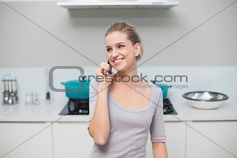 Happy gorgeous model phoning