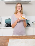 Happy gorgeous model holding plate with sandwich
