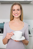 Cheerful gorgeous model holding plate with cup
