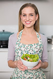 Happy gorgeous model holding salad bowl