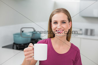 Blonde casual woman holding mug