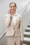 Smiling stylish businesswoman phoning