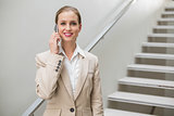Cheerful stylish businesswoman phoning