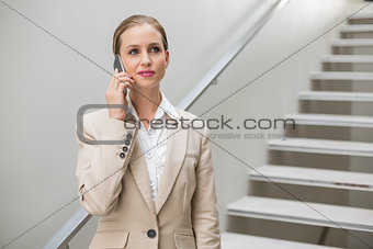 Thoughtful stylish businesswoman phoning