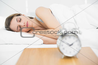 Calm woman lying on her bed under the cover sleeping