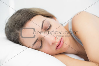 Cute young woman lying on her bed in the bedroom