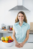 Content young woman posing in kitchen