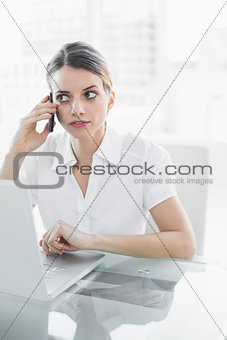 Attractive businesswoman phoning with her smartphone