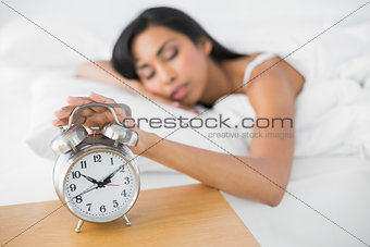 Attractive tired woman sleeping lying in her bed