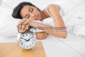 Beautiful exhausted woman sleeping lying in her bed