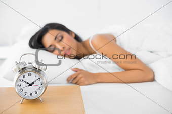 Calm beautiful woman sleeping lying in her bed