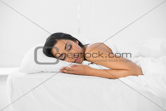 Calm sleeping woman lying on her bed