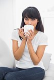 Content relaxed woman drinking of cup