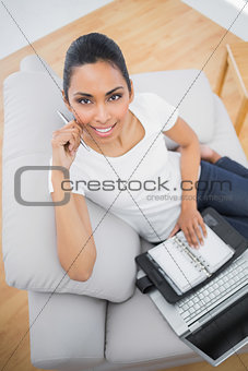 Attractive casual woman holding her diary and notebook