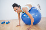 Lovely fit woman training on fitness ball