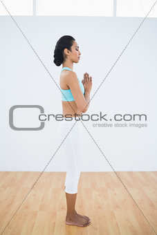 Calm relaxed woman standing in fitness hall