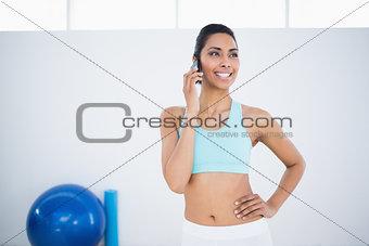 Beautiful smiling woman wearing sportswear phoning