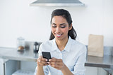 Content woman text messaging with her smartphone