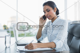 Beautiful businesswoman working sitting at her desk
